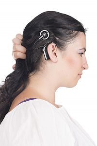 young deaf and hearing impaired woman with cochlear implant